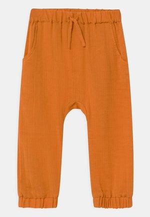 LOKI BABY  - Trousers - orange