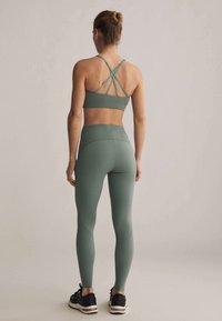 OYSHO - Light support sports bra - green - 2