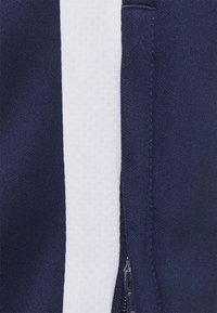 Puma - TEAMLIGA TRAINING PANTS - Jogginghose - peacoat/white - 4