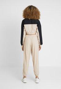 adidas Originals - TRACK PANTS - Trousers - ash pearl - 2