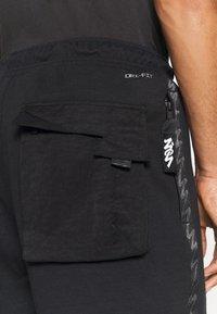 Jordan - ZION WILLIAMSON PANT - Spodnie treningowe - black/white - 4