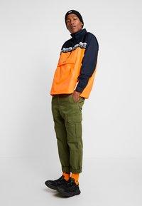 adidas Originals - REVEAL YOUR VOICE - Windbreakers - flash orange - 1