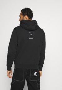 Nike Sportswear - HOODIE  - Jersey con capucha - black - 2