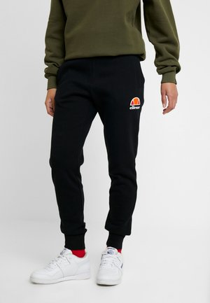 QUEENSTOWN - Tracksuit bottoms - black