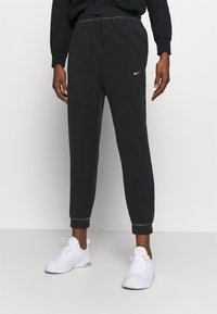 Nike Performance - Pantalones deportivos - black/metallic gold - 0