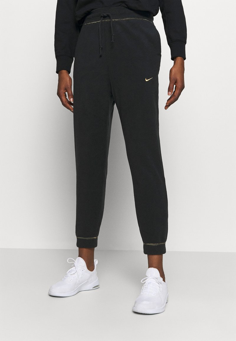 Nike Performance - Pantalones deportivos - black/metallic gold