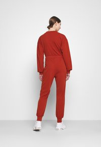 Missguided - JOGGER - Tracksuit bottoms - rust - 2
