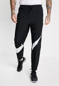 Nike Sportswear - PANT - Pantalon de survêtement - black/white - 0