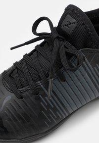 Puma - FUTURE Z 4.1 TT JR UNISEX - Astro turf trainers - black/asphalt - 5