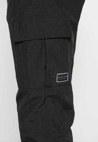 Criminal Damage - UTILITY JOGGER - Cargo trousers - black - 4