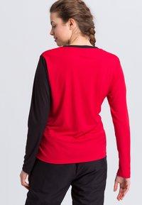 Erima - Sports shirt - red/black/white - 2