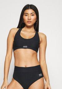Calvin Klein Swimwear - CORE POOL BRALETTE - Bikini top - black - 0