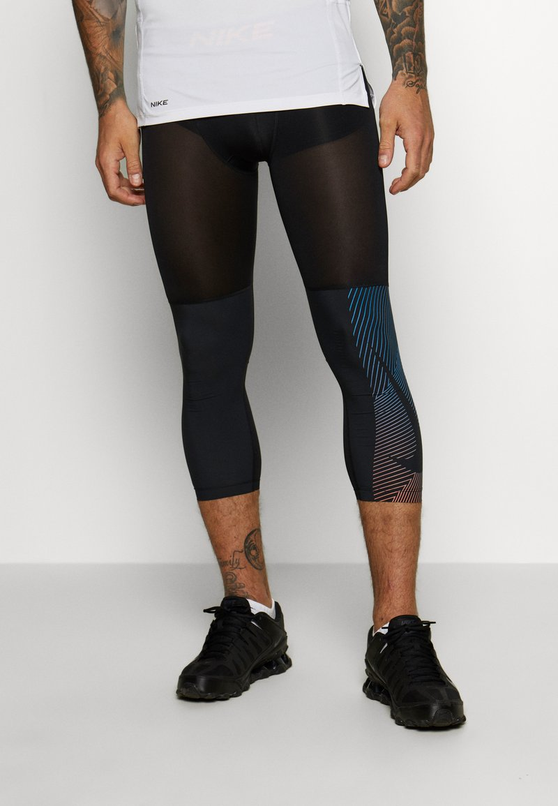 Nike Performance - Leggings - black