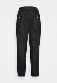Jordan - TRACK PANT - Pantalon de survêtement - black/university gold - 1