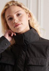 Superdry - RIPSTOP - Light jacket - black - 1