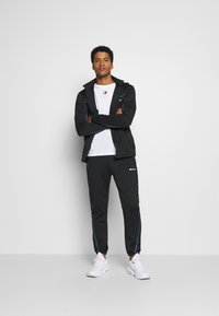 Ellesse - ROMANO - Tracksuit bottoms - black - 1