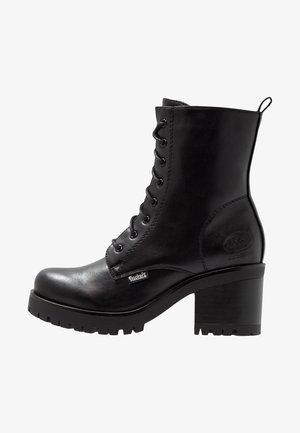 Platform ankle boots - schwarz/dunkelgrau