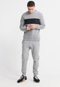 Superdry - Tracksuit bottoms - grey - 1