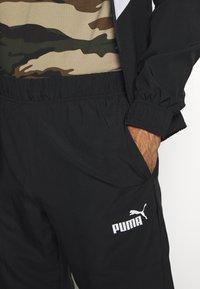 Puma - RETRO TRACKSUIT - Tracksuit - black - 8
