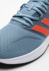 adidas Performance - RUNFALCON UNISEX - Neutral running shoes - tactile blue/semi solar red/core black - 4