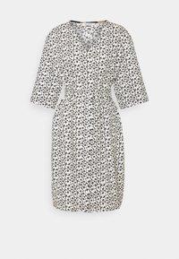 Marimekko - IHMETYS PIKKUINEN UNIKKO DRESS - Day dress - black/off-white - 4