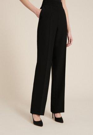 OSSIA - Trousers - black