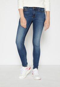 TOM TAILOR DENIM - JONA - Jeans Skinny Fit - clean mid stone blue denim - 0