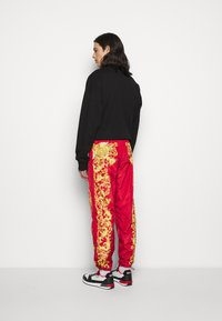 Versace Jeans Couture - PRINT BAROQUE - Tracksuit bottoms - red - 2