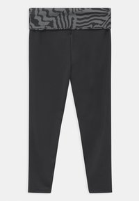 Nike Sportswear - PRINTED - Leggings - Trousers - black - 1