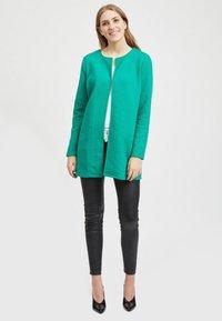 Vila - VINAJA NEW LONG JACKET - Summer jacket - pepper green - 1