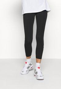 Nike Sportswear - FEMME - Leggings - Trousers - black - 0