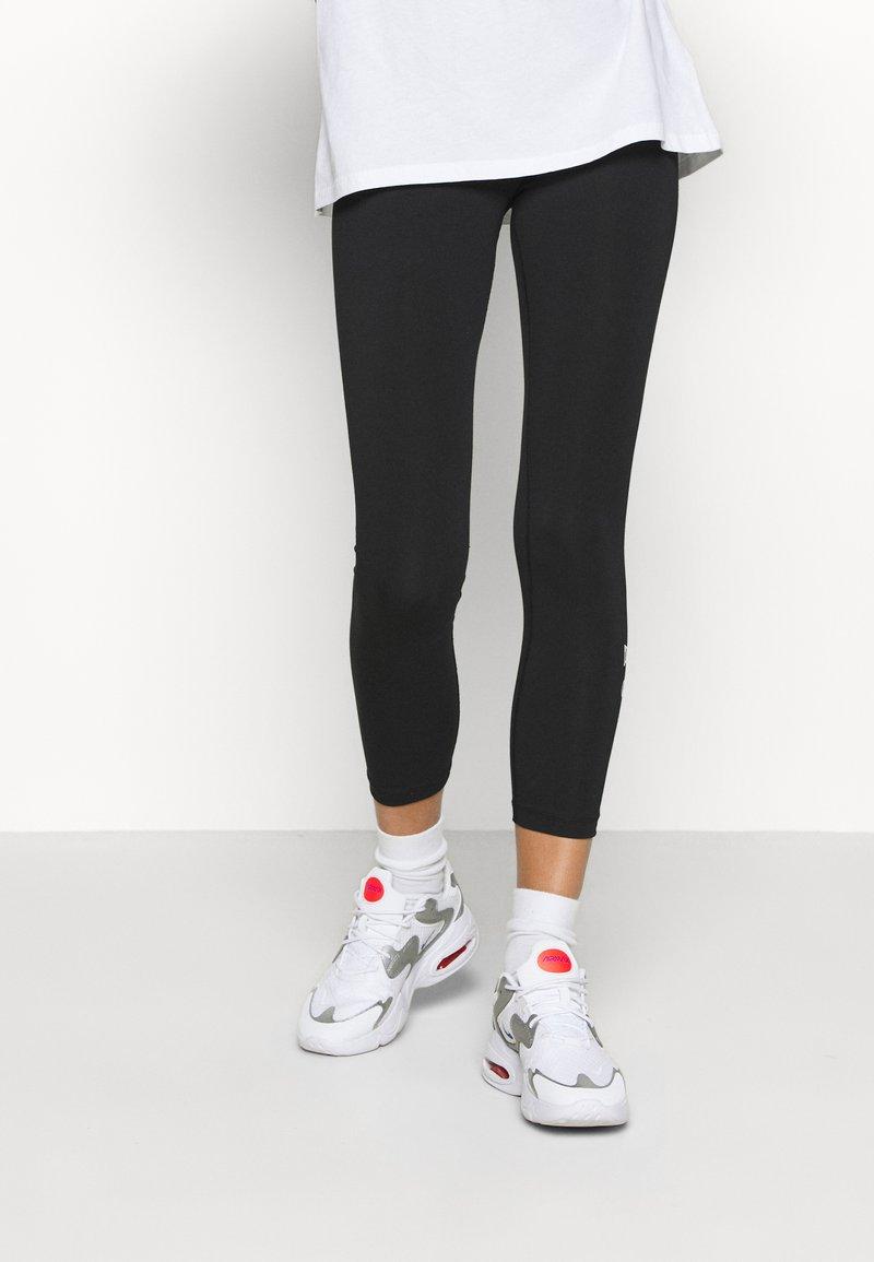 Nike Sportswear - FEMME - Leggings - Trousers - black