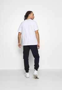 Champion - CUFF PANTS - Tracksuit bottoms - navy - 2