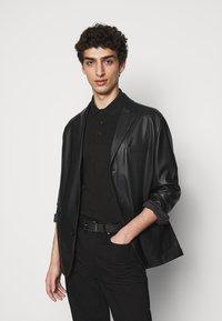 KARL LAGERFELD - Polo shirt - black - 4