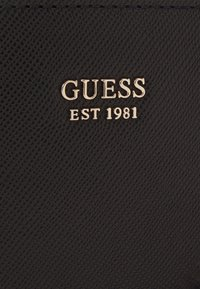 Guess - KATEY MINI TOP ZIP SHOULDER - Håndveske - black - 4