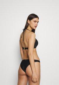 Tommy Hilfiger - SOLIDS PUSH UP - Bikini top - black - 2