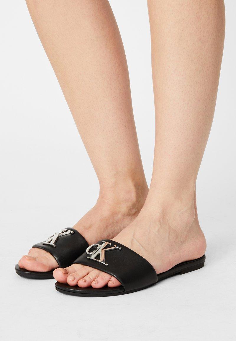 Calvin Klein Jeans - FLAT SLIDE  - Sandalias planas - black