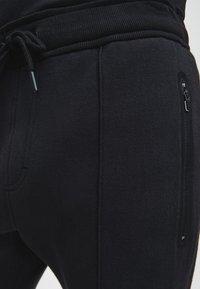 Calvin Klein - Pantaloni sportivi - ck black - 4