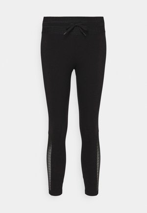 DESAGUJADO - Leggings - Trousers - black