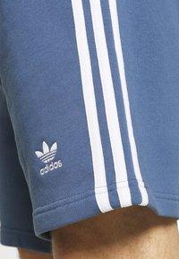 adidas Originals - 3 STRIPE UNISEX - Tracksuit bottoms - crew blue - 4