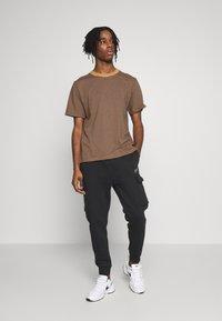 Nike Sportswear - Verryttelyhousut - black - 1