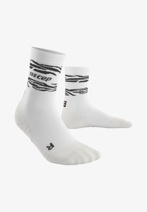 ANIMAL COMPRESSION MID CUT SOCKS - Sports socks - white/black