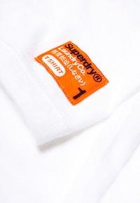 Superdry - 2 PACK - T-shirt basic - laundry white / laundry black - 4