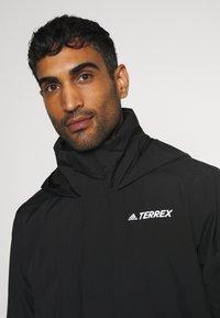 adidas Performance - FOUNDATION RAIN.RDY HIKING JACKET - Hardshell jacket - black - 4