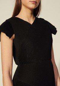 sandro - ODETTE - Cocktail dress / Party dress - noir - 4
