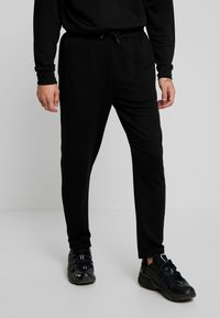 Urban Classics - TERRY TAPERED - Tracksuit bottoms - black - 0