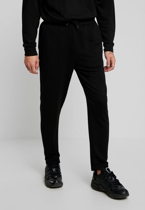 TERRY TAPERED - Tracksuit bottoms - black