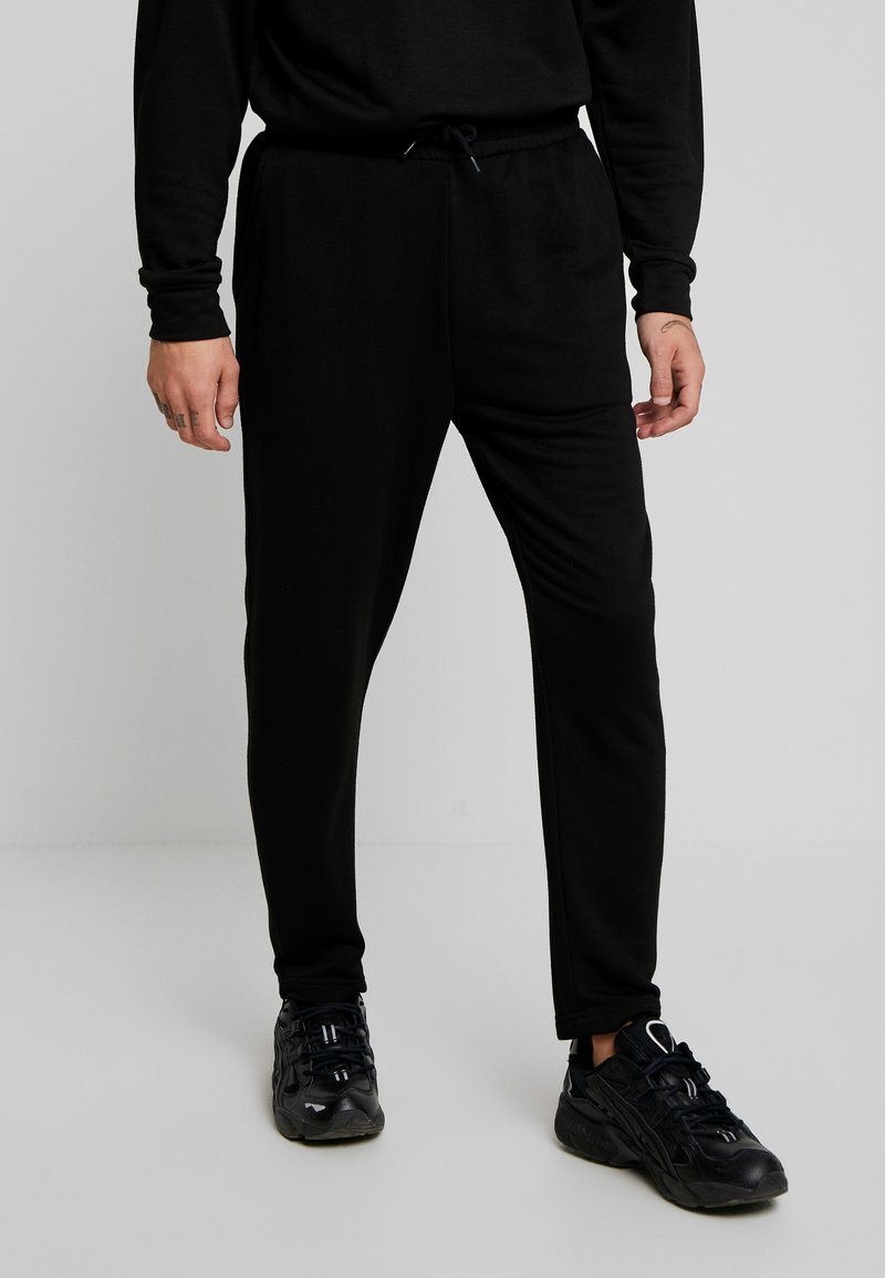 Urban Classics - TERRY TAPERED - Tracksuit bottoms - black