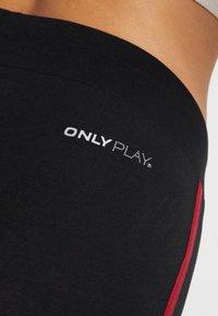 ONLY Play - ONPTERRA LEGGINGS - Leggings - black/beet red - 4