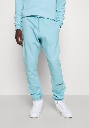 LOGO UNISEX - Pantalon de survêtement - sky blue